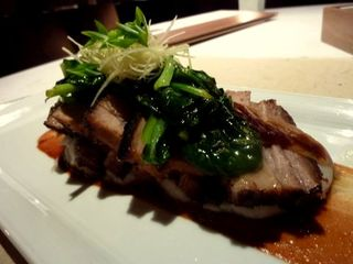 Entree at Bei: black pork belly